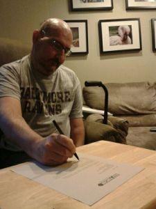 Daron signing check